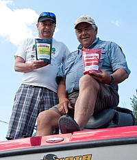 Al Sebastian and Tony Puccio on Tony's boat with a couple bags of Canadian Classic Fishfry.